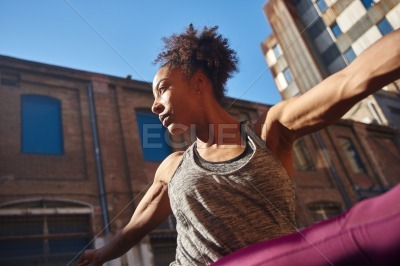 Young woman working out alone in the city