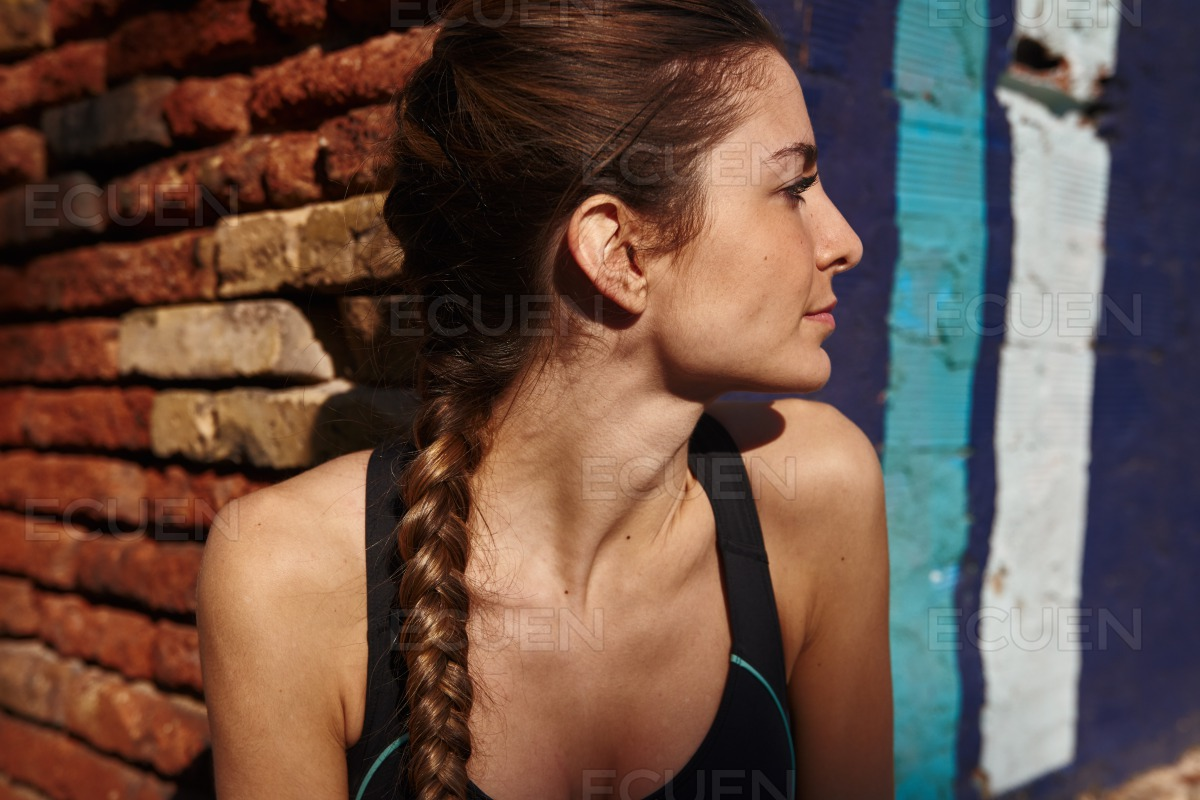 Woman leans forward into the camera as she turns stock photo
