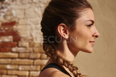 Pretty young woman is looking into the distance
