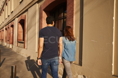 Rear view of a couple walking in the street