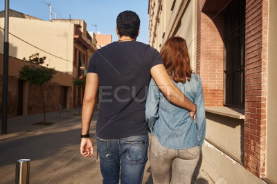 Rear view of a young couple walking
