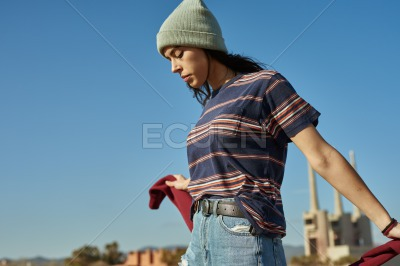 A carefree young lady enjoying the outdoors