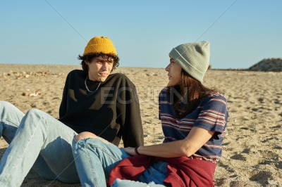 Attractive young couple chatting together outdoors