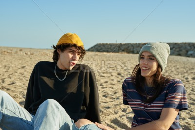 Happy young couple having a chat outdoors