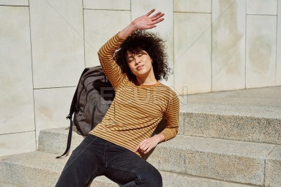 Cute girl blocking the sun with her hand
